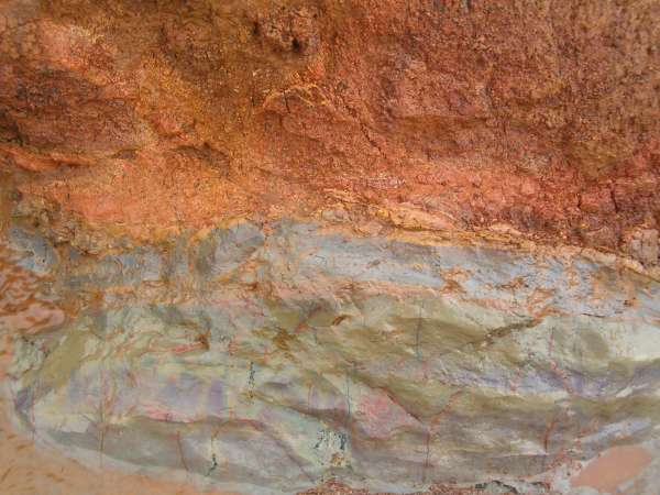 Crumbly red clay layer on top of smooth grey clay