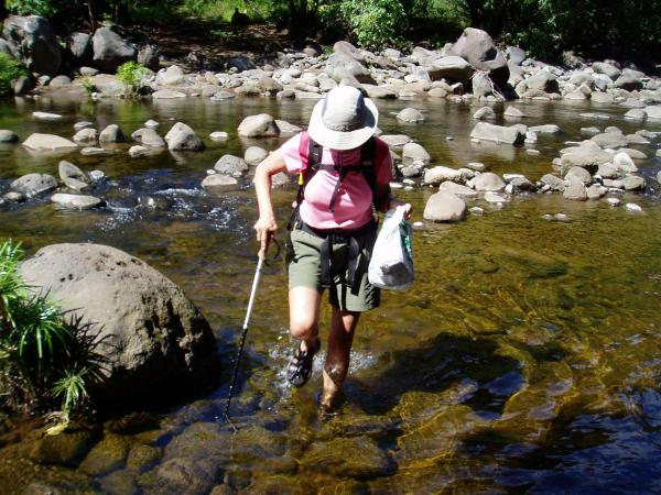 Fording the Waime River in shallow water and on exposed rocks