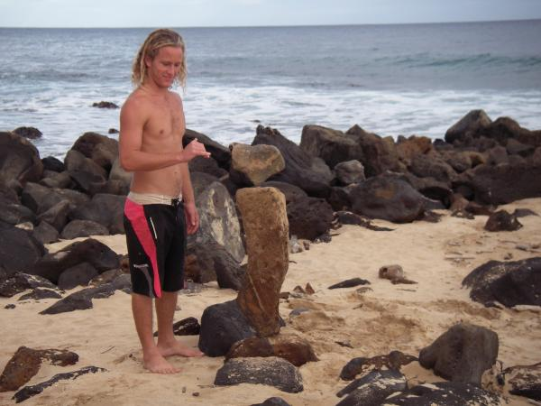 Kyle throwing a shaka in front of his double balancing rocks