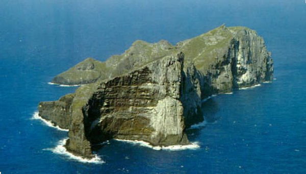 Nihoa is 171 acres, about 1 sq km, with 900 foot cliffs, 300 meters, to the east and steep slopes on the west