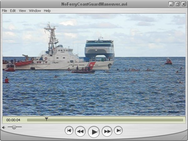 Click to download 60 MB movie of Coast Guard herding serfers with their big ship
